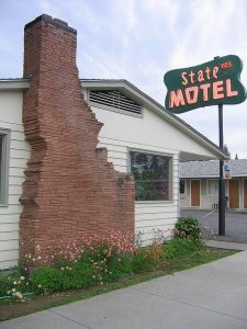 The State Motel in Coeur d'Alene Idaho, with a chimney shaped like the state.